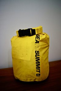 yellow dry sack filled with gear