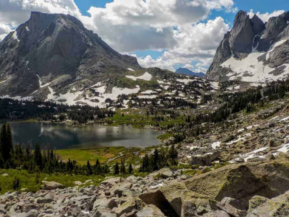 Alpine lake surrounded by jagged mountain peaks