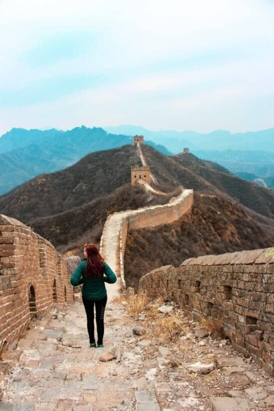 standing on top of the great wall of china