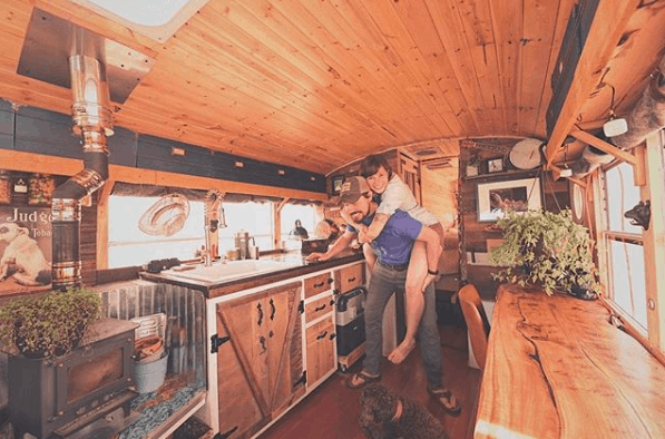 Zac and Tiffany inside their skoolie bus conversion
