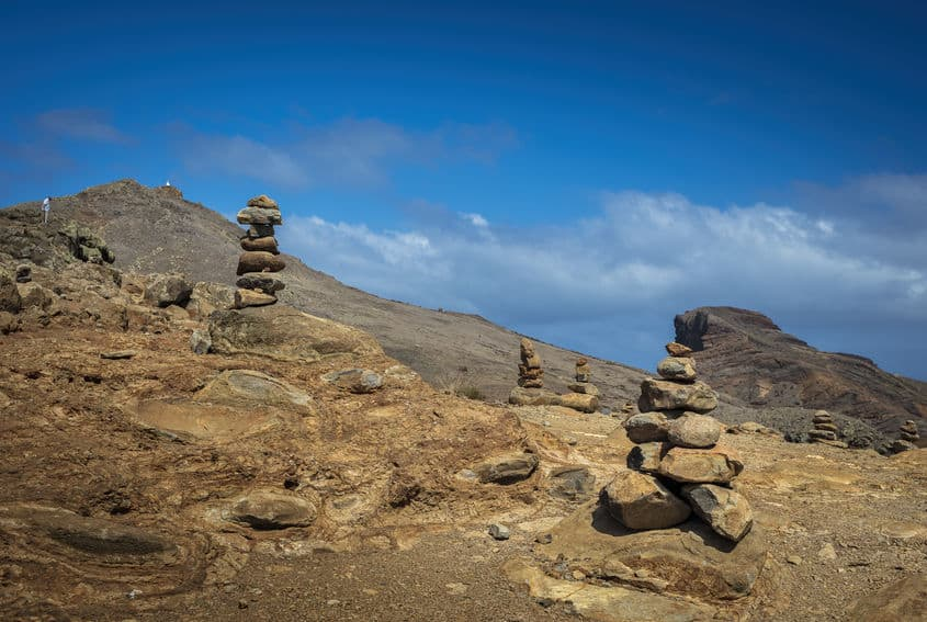 stacked stones vs navigational cairn