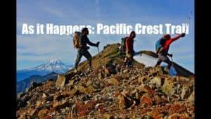 hikers walking over rocky terrain