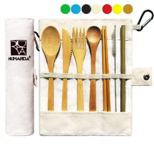 white fabric roll-up case with light brown utensils