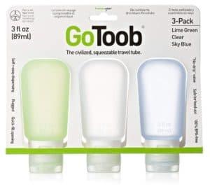 three squishy clear toiletries bottles