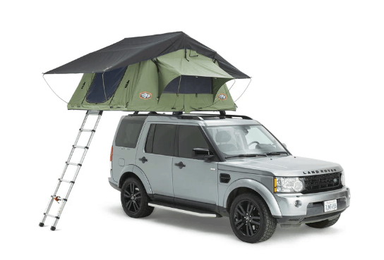 green tent on top of white SUV
