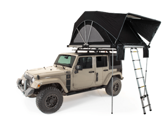 black roof top tent on beige jeep
