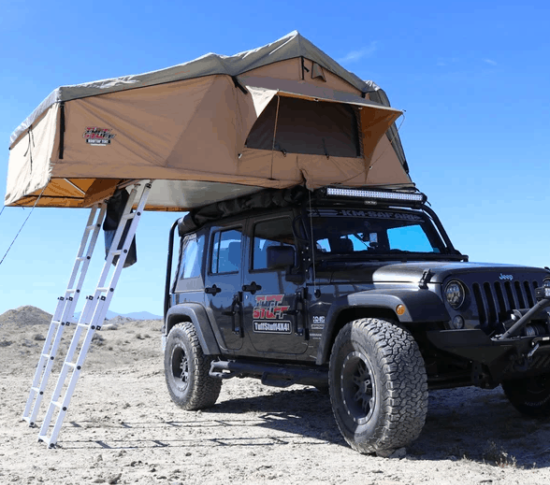 beige roof top tent on black truck