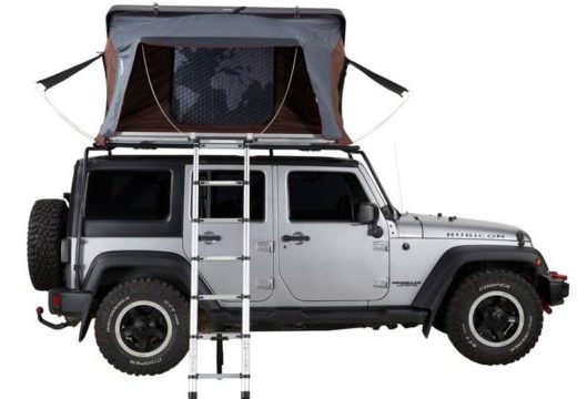 white jeep with roof top tent