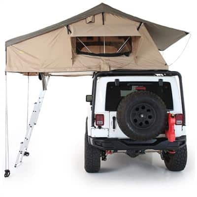 brown tent on top of white jeep