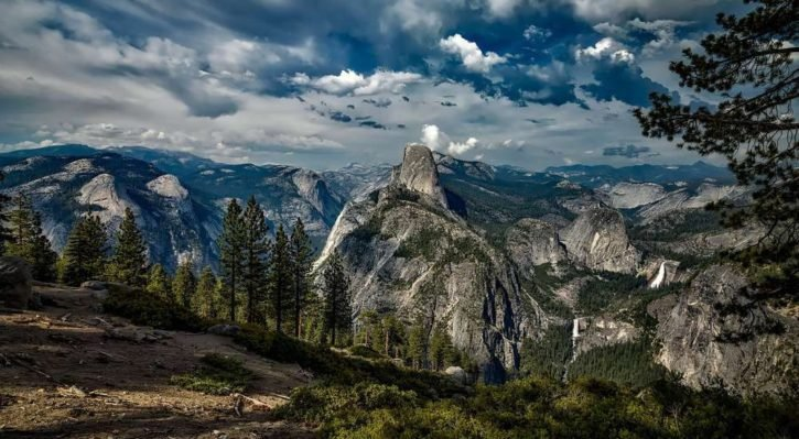 view of yosemite with dark clouds overhead