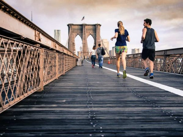 people running on the brooklyn bridge