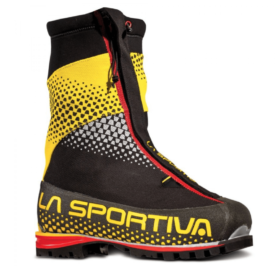 black, yellow, and red moutnaineering boot on white background