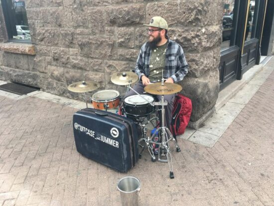 Aaron earns most of his money by street performing