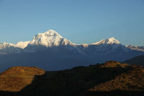 snow-capped dhalugiri with blue sky in background