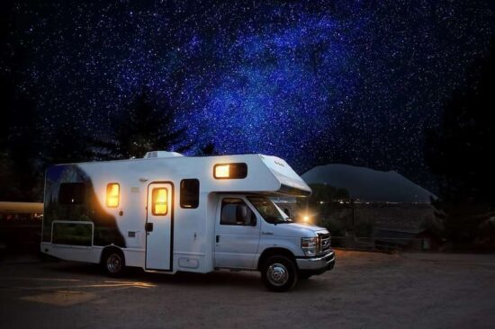 RV with starry sky in background