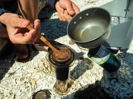 boiling water to pour into coffee maker at campsite