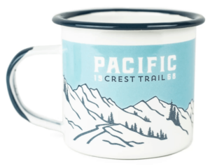 white and blue mug with pacific crest trail logo on front