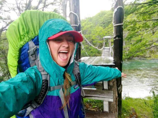 girl in hiking gear in the rain