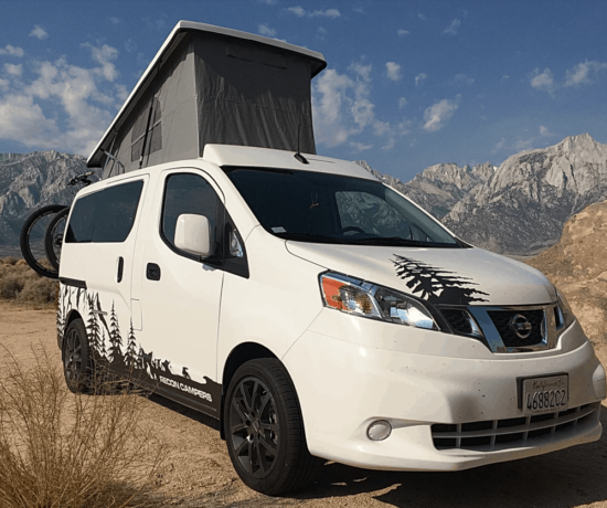 converted white nissan nv2000 with pop top