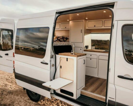 white converted sprinter van exterior view