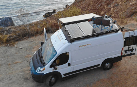 white ram promaster van with custom modifactions on road overlooking the ocean