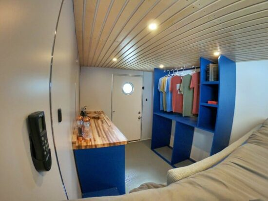 inside of a conerted box truck showing kitchen and living areas