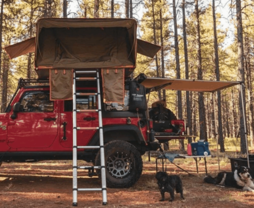 brown roof top tent on red jeep