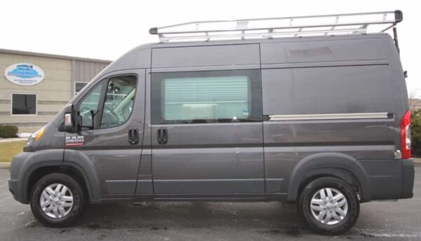 grey promaster in parking lot